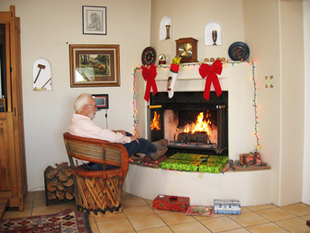 Al sitting near fireplace